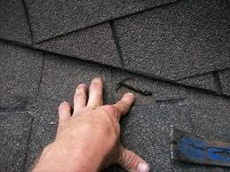 roof.net-skylight-leak-repair-va-damaged-shingles