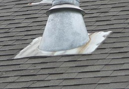 Image of improperly installed furnace stack pipe flashing that will cause the roof to leak in Fairfax Virginia