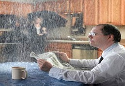 Image of a man ignoring a roof leak that can cause a fire and severe interior damage
