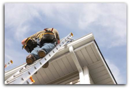 Photo of Roofer checking for gutter failure and Roof inspection in Virginia