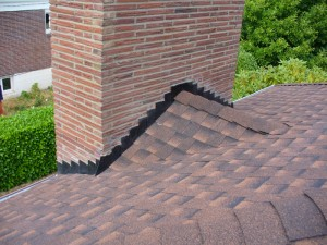 Image of Roofing Repair Contractors use a Chimney Cricket in Virginia